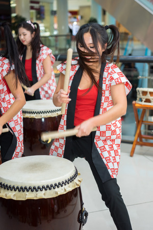 Moscow, Russia - March 25, 2017: group of Japanese Taiko drummers girls perform in Kaleidoscope shopping center on the at the opening of a new store UNIQLO Unique Clothing Warehouse. Editorial