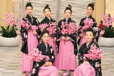 Moscow, Russia - March 24, 2017: group of Japanese geisha girls in traditional kimono in Riviera shopping center at the opening of a new store UNIQLO Unique Clothing Warehouse.