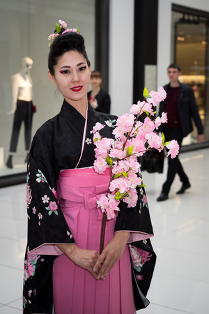 Moscow, Russia - April 02, 2017: geisha in traditional japanese kimono in the shopping center Otrada corridor during the Maintain a sushi record event.