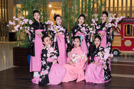 Moscow, Russia - April 02, 2017: group of Japanese geisha girls in traditional kimono in the shopping center Otrada corridor during the Maintain a sushi record event.