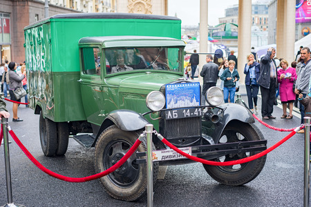 famous industries: Moscow, Russia - September 11, 2016: Moscow City Day. Moscow residents and guests celebrate the 869 anniversary of the city. Retro car GAZ-AA for military purposes 1937 edition.