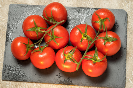 red ripe wet whole tomatoes