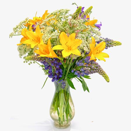 millefolium: Bouquet of wild flowers: achillea millefolium, day lily and lupine in a transparent glass vase isolated on white background