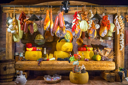 Kotor, Montenegro - September 04, 2017: storefront of Cogimar shop, a famous fish store in Montenegro. The showcase is decorated with an abundance of products - cheese, sausages, jamon, fruit, wine. Redactioneel