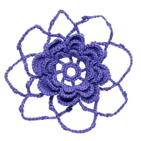 One crocheted flower element isolated on white background