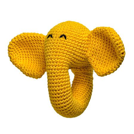 amigurumi crocheted yellow elephant toy isolated on white background