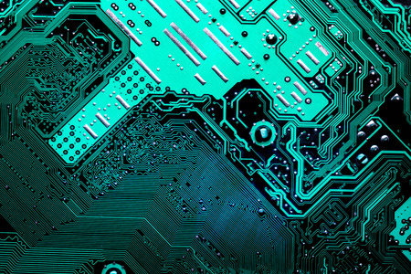 Close up of a printed blue computer circuit board Stock Photo