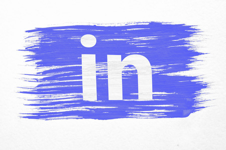 Moscow, Russia - March 24, 2018: closeup of art brush watercolor painting linkedin flag blown in the wind isolated on white. Logo animation. Linkedin is a business-oriented social networking service.