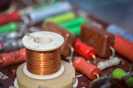 Induction coil with electronic components on an antique printed circuit board