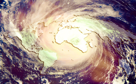 The concept of catastrophic climate change, Huge global hurricane on the background of the world map.