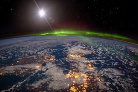 Ireland, United Kingdom and Scandinavia on a moonlit night under an amazing aurora.