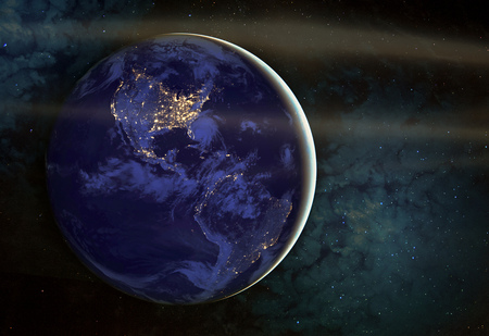 The Americas at night viewed from space with city lights showing human activity in United States (USA), Canada and Mexico, New York, California. The elements of this image furnished by NASA. Stock Photo