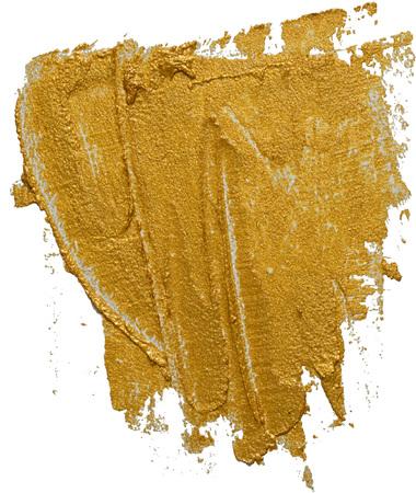 Golden cosmetics swatch smear. Gold texture brush stroke design element.