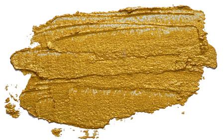 Textured hand drawn golden oil paint brush stroke isolated on white