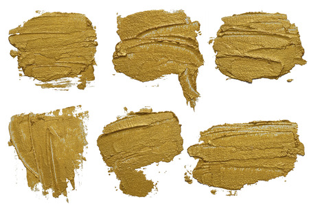 Set of six golden cosmetics swatch smears. Gold texture brush stroke design elements.