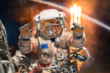 Astronaut in outer space. People in space. Stock Photo