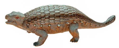 Ankylosaurus dinosaur toy figure, isolated on white Фото со стока