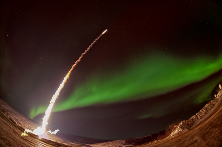 Missile launch at night with aurora polaris. Fish eye lens.