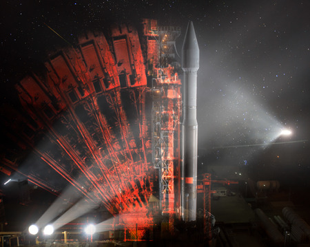 Missile launch preparation prelaunch at night, illumination from spotlights and Illusion of multiple rocker arms.