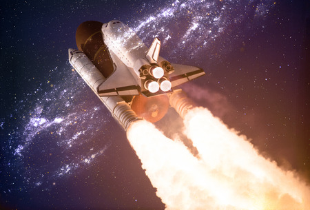 Spaceship taking off on a mission throw the warmhole portal in outer space Stock Photo