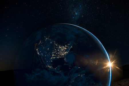 Night view of north America from the satellite to the glowing city lights on the sunrise from the east.