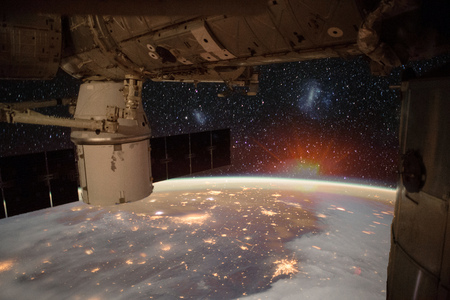 Spaceship on the orbit. Earth with view of Great lakes, Florida and Bahamas on the background.