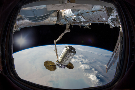 Earth in spaceship international space station window porthole. Dust storm clouds in Persian gulf. Stock Photo