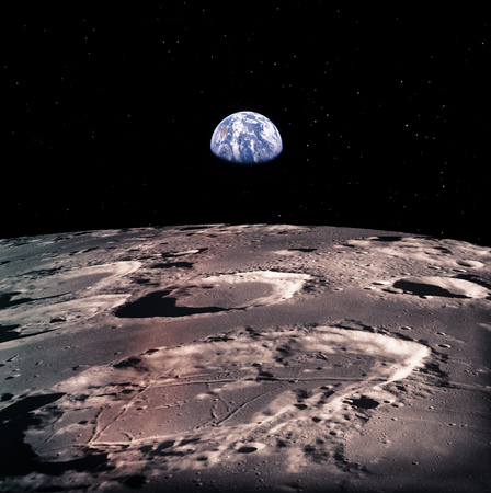 Earth rises above lunar horizon with huge meteor craters.