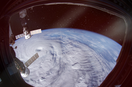 Hurricane is seen from spaceship porthole.