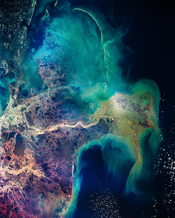 Distribution pattern of muddy fresh water from the Mississippi River as it flows into the Gulf of Mexico. New Orleans. Colorful collage.