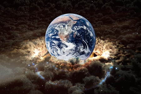 Planet Earth with surrounding clouds, collage. Stock Photo