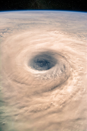 Super massive typhoon eye from the space. Banco de Imagens