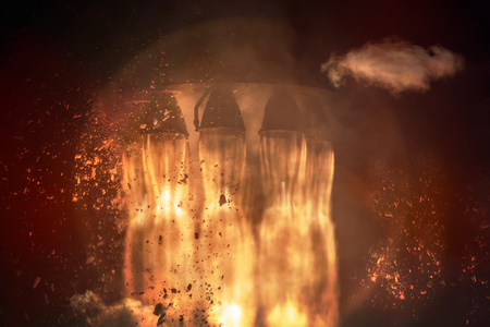 Rocket engines and fire during the missile launch at night, close up.
