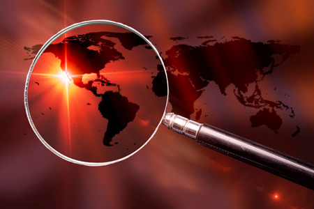 World map with magnifying glass - conceptual global search image.