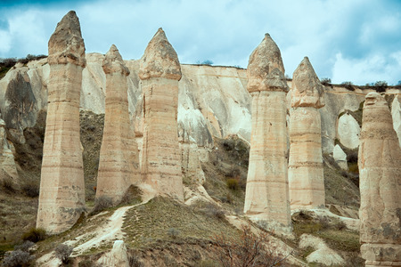 Love valley with huge phallus shape stones in Goreme village, Turkey. Rural Cappadocia landscape. Volcanic tuff mountains in Goreme national park. Countryside lifestyle.