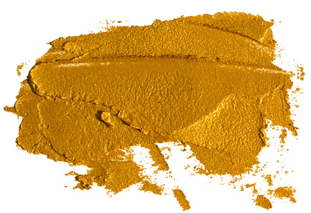 Smear of crushed golden eyeshadow as sample of cosmetics product isolated on white Stockfoto