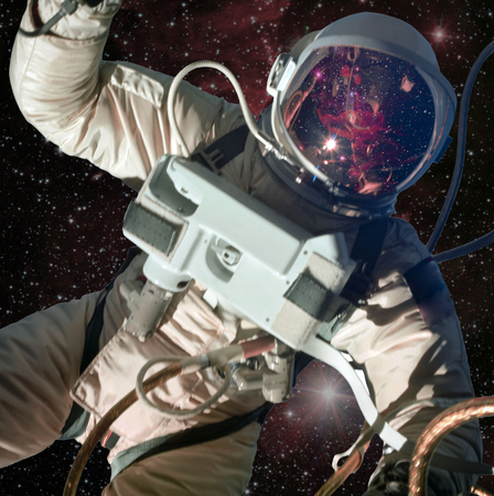 Astronaut in outer space with galaxy reflection on the helmet. 免版税图像