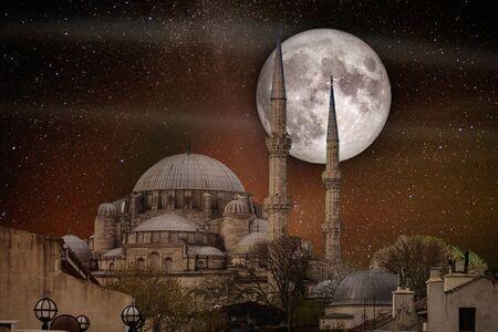 Full moon over the Faith Mosque (Conqueror's Mosque), Istanbul, Turkey.