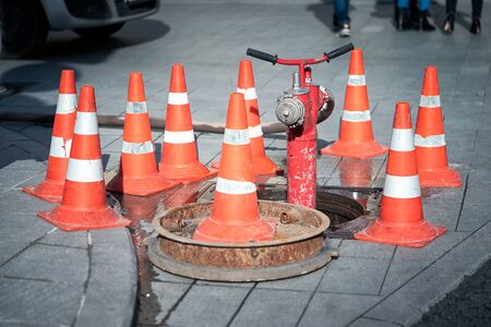 hydrant surrounded by cones on a carriageway Stock fotó