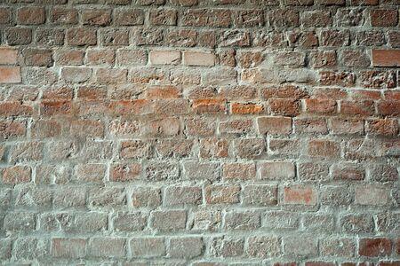 Antique brickwork of white painted red bricks.