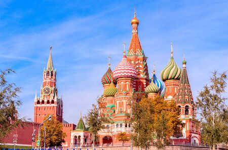 Spasskaya Tower, the Moscow Kremlin and St. Basils Cathedral. Architecture and sights of Moscow.