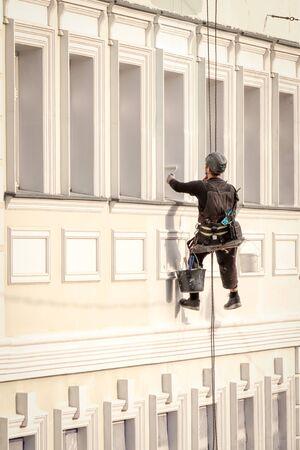 Washer wash the windows of high skyscraper, high risk work