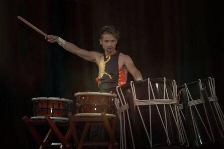 Taiko drummer drum drums on stage on a black background 写真素材 - 132088060