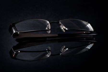 Glasses on a dark background.