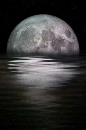 Blue moon rising out of the sea. Elements of this image furnished by NASA.