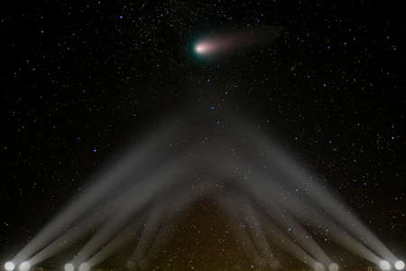 Comet asteroid flies towards the earth, illuminated by spotlights.