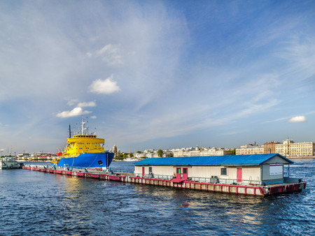 Icebreaker diesel near the pier on the Neva River in the city of St. Petersburg on a summer sunny day next to the passenger terminal Stock Photo