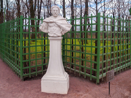 Bust sculpture of Polish Pan Jan Sobieski in the park Summer Garden near the green grid to support plants in April before the start of the summer park season in St. Petersburg Stock Photo