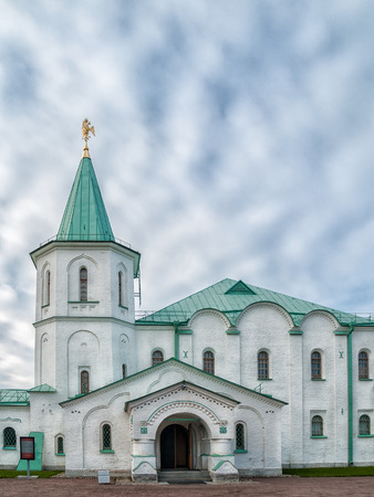 Part of the architectural complex Ratnaya Chamber with a turret, a facade, a spire, a three-headed eagle on a spire against a blue sky in Tsarskoye Selo in Alexander Park St. Petersburg, Russia Stock Photo