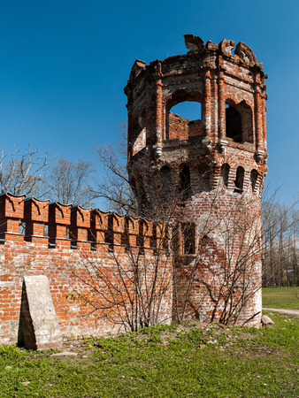 Destroyed corner observation tower of red brick in the architectural complex Fedorovsky town in the Alexander Park in Tsarskoye Selo in St. Petersburg, Russia